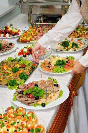 Banquet table served with canape