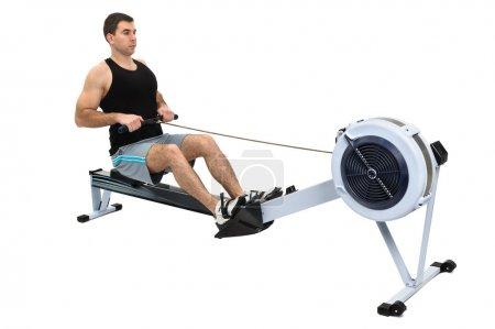 Man doing indoor rowing