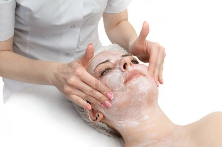 facial massage with scrub mask