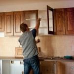 Carpenter working on new kitchen cabinets...