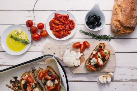 Photo for Bruschetta with tomatoes, pepper, mozzarella and garlic - Royalty Free Image