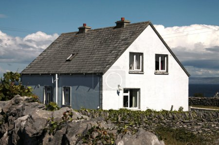 White small house in its yard in Inisheer, Aran Is...