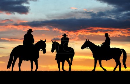 Photo for Silhouette cowboys with horses in the sunset - Royalty Free Image