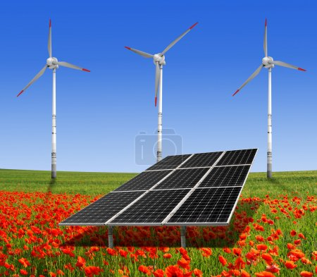 Foto de Paneles de energía solar y de la turbina de viento en el campo de amapolas - Imagen libre de derechos