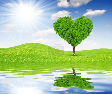Photo for Spring landscape with tree in the shape of heart - Royalty Free Image