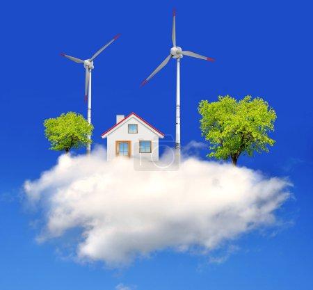 Photo pour Maison avec des éoliennes sur le nuage - image libre de droit