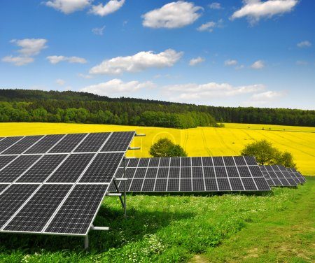 Photo for Solar energy panels against blue sky with clouds - Royalty Free Image