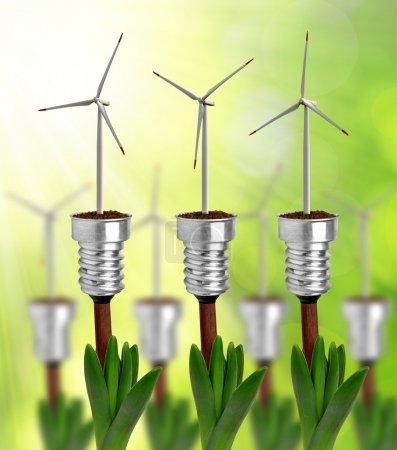 Photo pour Ampoule avec éolienne en usine - concept d'énergie verte - image libre de droit