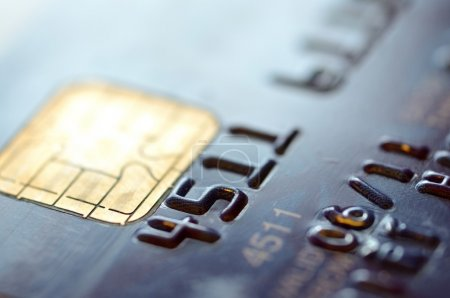 Photo for Low key macro shot with old credit card. - Royalty Free Image