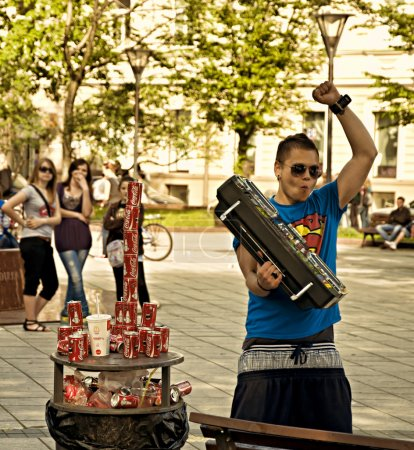 Photo for Dancing Yong Man like Coca Cola with super man shirt - Royalty Free Image