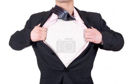 Photo pour Homme agissant comme un super héros et ouvrant sa chemise isolée sur fond blanc - image libre de droit