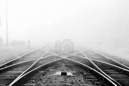 Railway in fog on station, outdoor landscape...