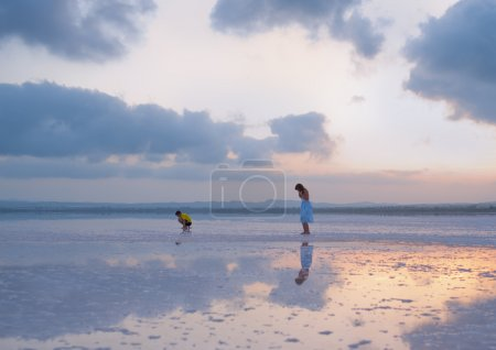 Children walk on Salty shore of the Laguna Salada de Torrevieja,