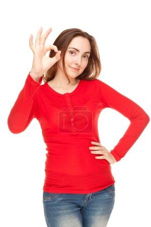Beautiful woman giving okay sign