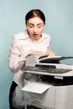 Businesswoman with smoking copier