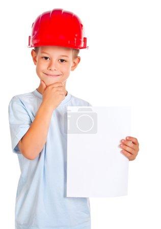 Photo pour Petit garçon avec une feuille de papier et un casque. isolé - image libre de droit