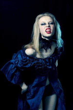 Aggressive vampire woman looking at camera