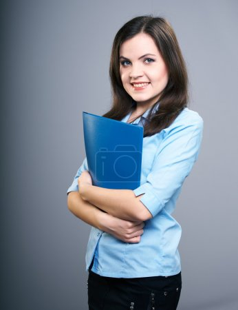 Attractive young woman in a blue blouse. Woman holds a blue fold