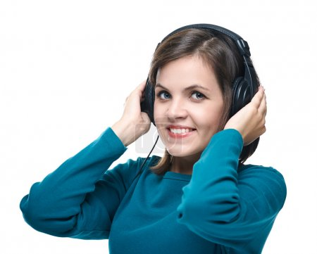 Attractive young woman in a blue shirt. Woman with headphones li