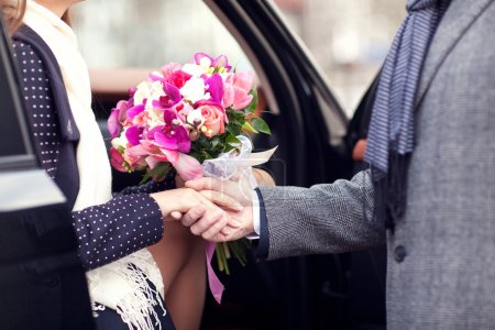 The guy gives girl a bouquet of flowers