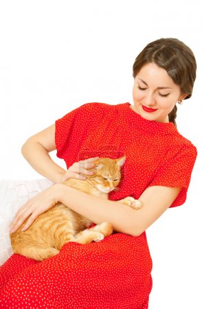 Beautiful woman in red dress with a cat