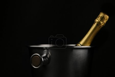 Photo for Champagne bucket over black - Royalty Free Image