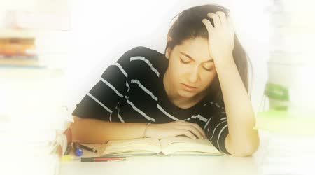 Tired woman studying