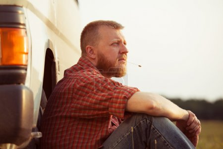 Photo for Red-bearded man in jeans on a summer evening - Royalty Free Image