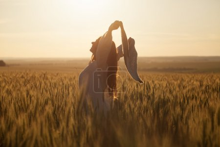 Photo for Happy young woman with a shawl in field - Royalty Free Image