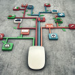 White mouse on concrete floor with media icons con...