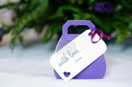 Photo for Closeup of violet wedding favours gift at wedding reception - Royalty Free Image
