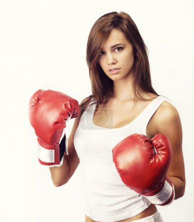 Attractive woman wearing boxing gloves