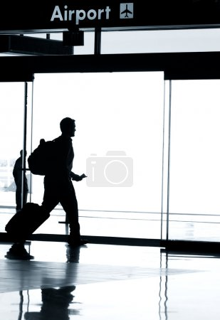 Silhouette of man in Airport terminal
