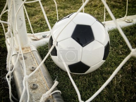 Photo for Goal. Football soccer ball in the back of the net - Royalty Free Image
