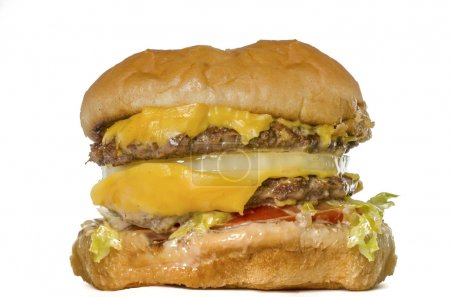 Fast food double burger isolated against white background