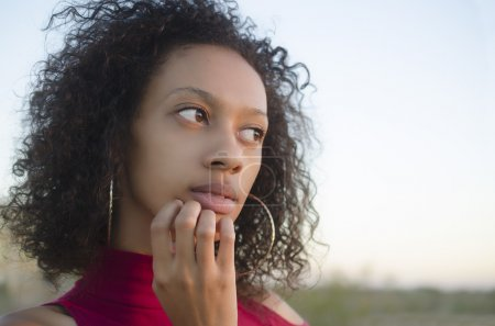 Photo for Portrait of young woman thinking - Royalty Free Image