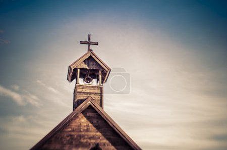 Rural old fashioned church steeple with bell