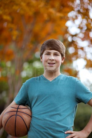 Handsome Teenager with Basketball