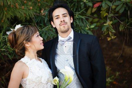 Beautiful happy Bride and Groom Mixed Ethnicity un...