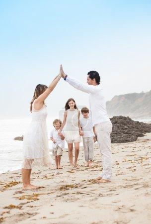 Happy Healthy Family at the beach vacationing in Malibu California