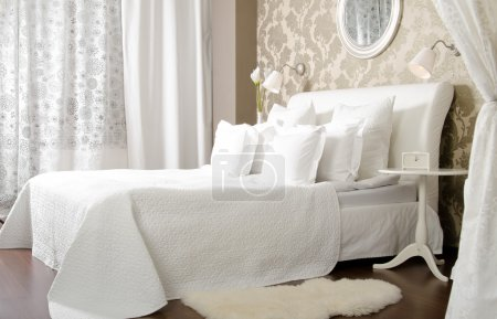 Photo for Big the white double bed in light bedroom, in hotel - Royalty Free Image