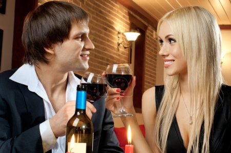 Photo for Romantic evening date in hotel room, or supper in restaurant, happy couple with wine glass - Royalty Free Image
