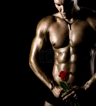 Photo for The very muscular handsome sexy guy on black background, naked torso - Royalty Free Image