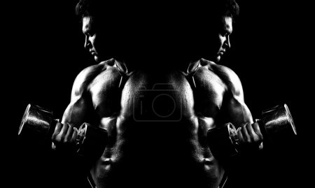 Photo for Very power athletic guy , execute exercise with dumbbells, on bkack background, black-and-white - Royalty Free Image