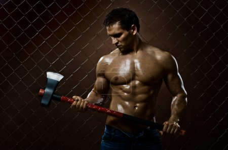 The beauty muscular worker chopper man with big he...