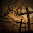 Group of wooden cross on graveyard, night horror l...