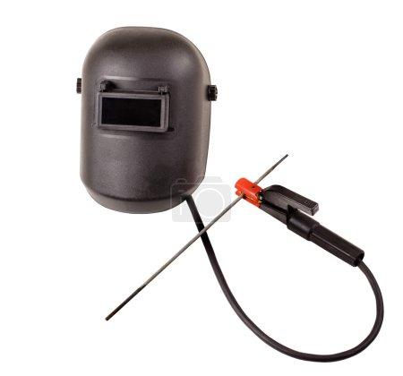 Photo pour Nature morte de l'écran de protection noir et support de tige avec câble et électrode, pour le soudage à l'arc électrique, sur fond blanc, isolé - image libre de droit