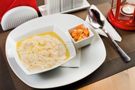 Ceramic white plate with  porridge
