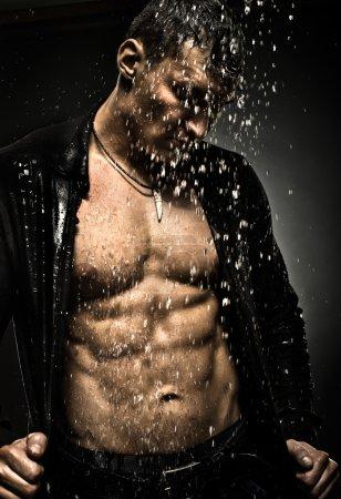 Muscular,sexy guy under shower