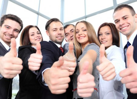 Successful young business showing thumbs up
